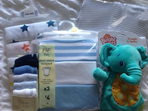 Muslin squares, babygros, socks and a teething toy from Aunty Clare, Mamgu (Welsh nan!) and some family friends