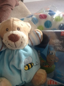 Spotty blanket, nursery rhyme CD and rattly, cuddly bear from work