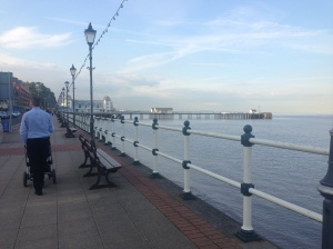 Daddy walking Baby to Penarth Pier