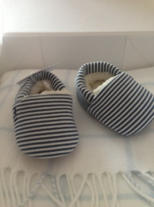 Beautiful booties and blanket from The White Company, from a supplier at work