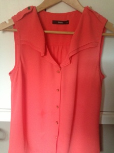 Coral blouse with gold button detail from Oasis