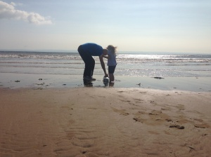 W's cousin and bampa at Porthcawl beach