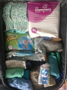 half-packed suitcase for our baby!