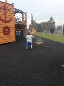 Toddling around Aberystwyth castle in his first shoes!