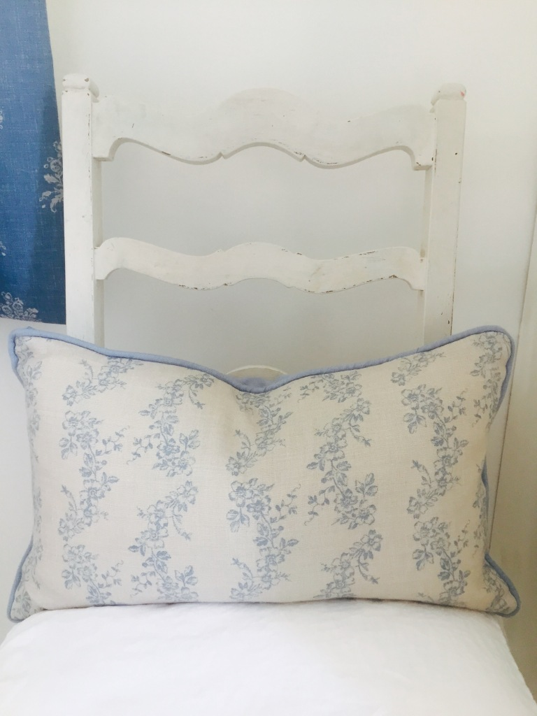 shabby chic white chair blue cushion