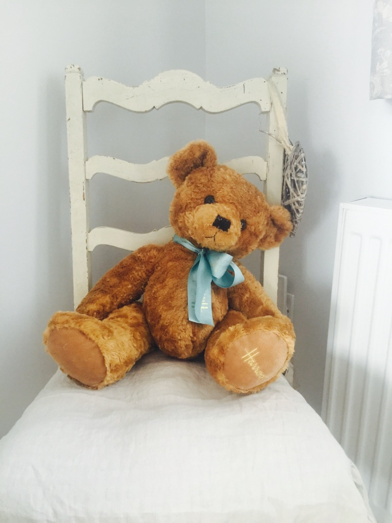 old teddy bear on white shabby chic chair
