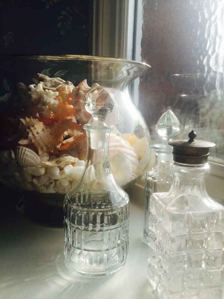 shells and glass bottles in bathroom