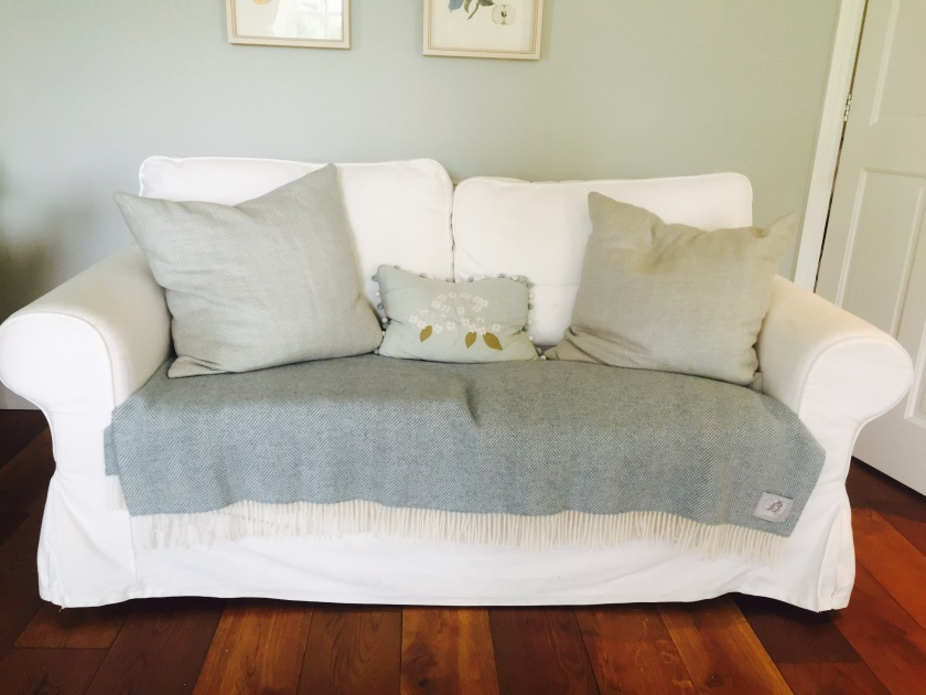 white sofa blue grey cushions