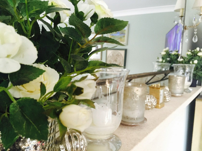flowers and candles on mantelpiece