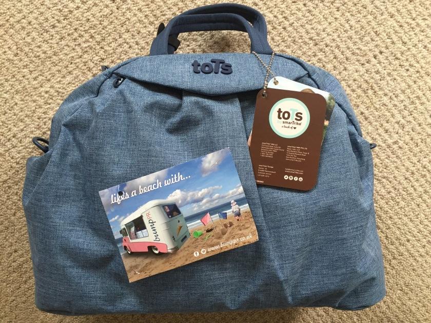 review tots by smartrike chic blue m lange changing bag. Black Bedroom Furniture Sets. Home Design Ideas