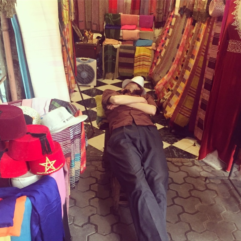 Man sleeping in his souk stall Marrakesh